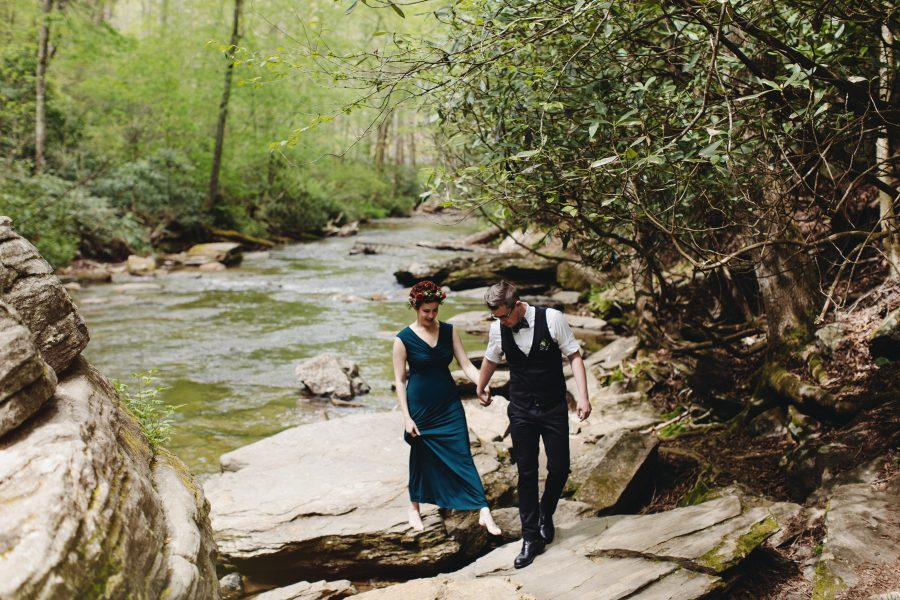 Couple getting married by a waterfall and they probably used a wedding ceremony script