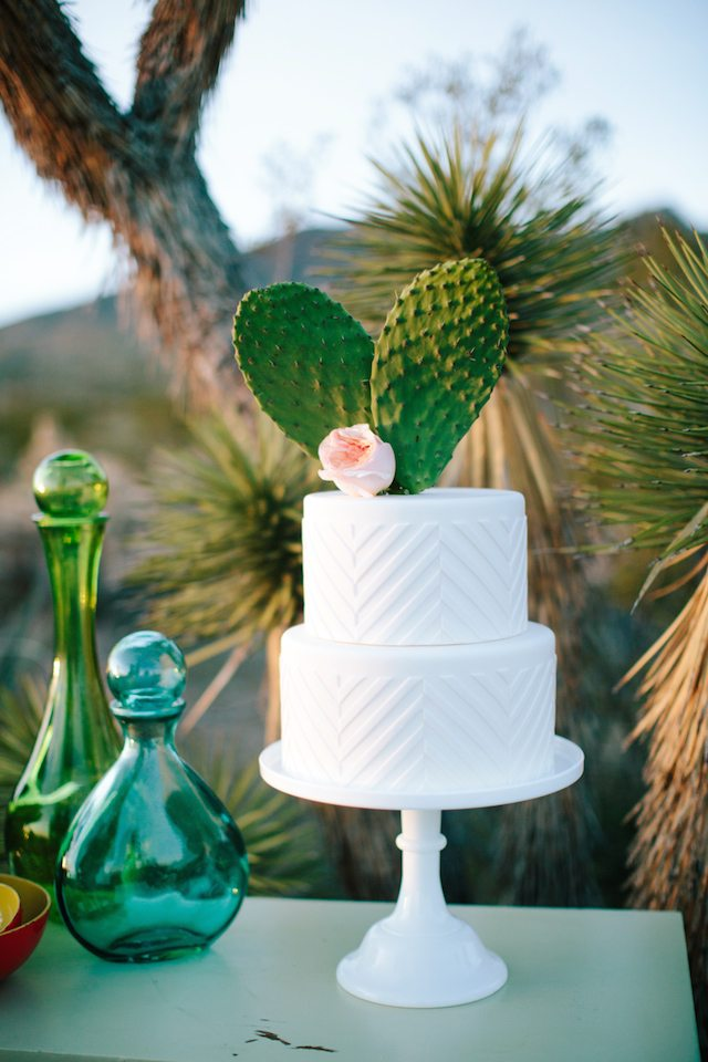 cactus paddles and a flower cake topper