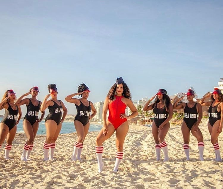 women in swimsuits on a beach