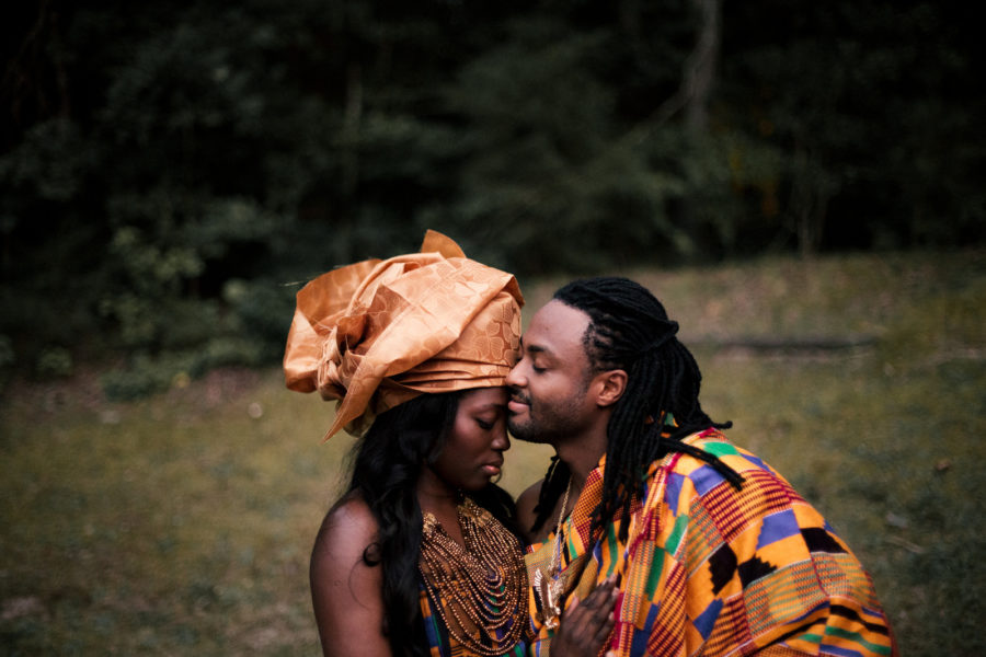 photo of man and woman in African clothing embracing