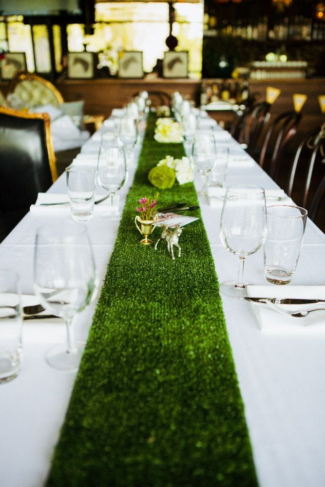 A green astro turf table runner