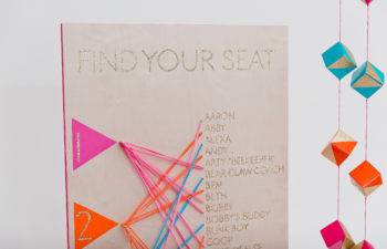Colorful seating chart made with brightly colored rubber bands