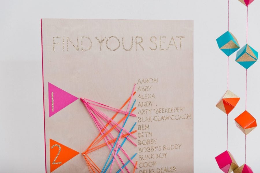 How to create your wedding seating chart a practical wedding colorful seating chart made with brightly colored rubber bands solutioingenieria Images