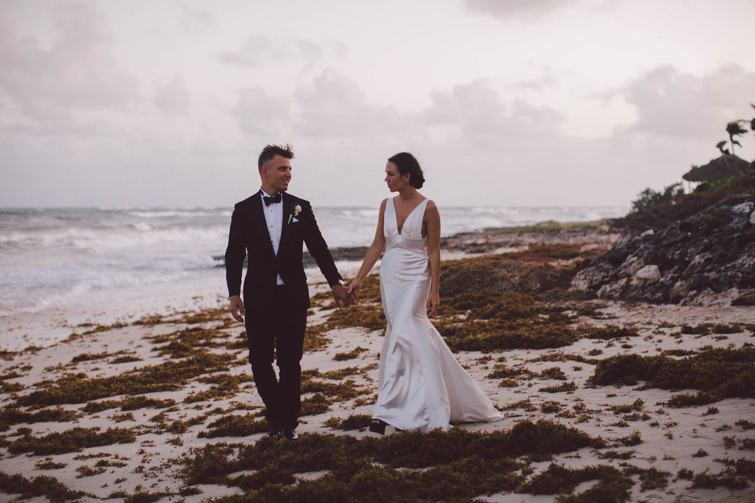 couple having a formal beach wedding