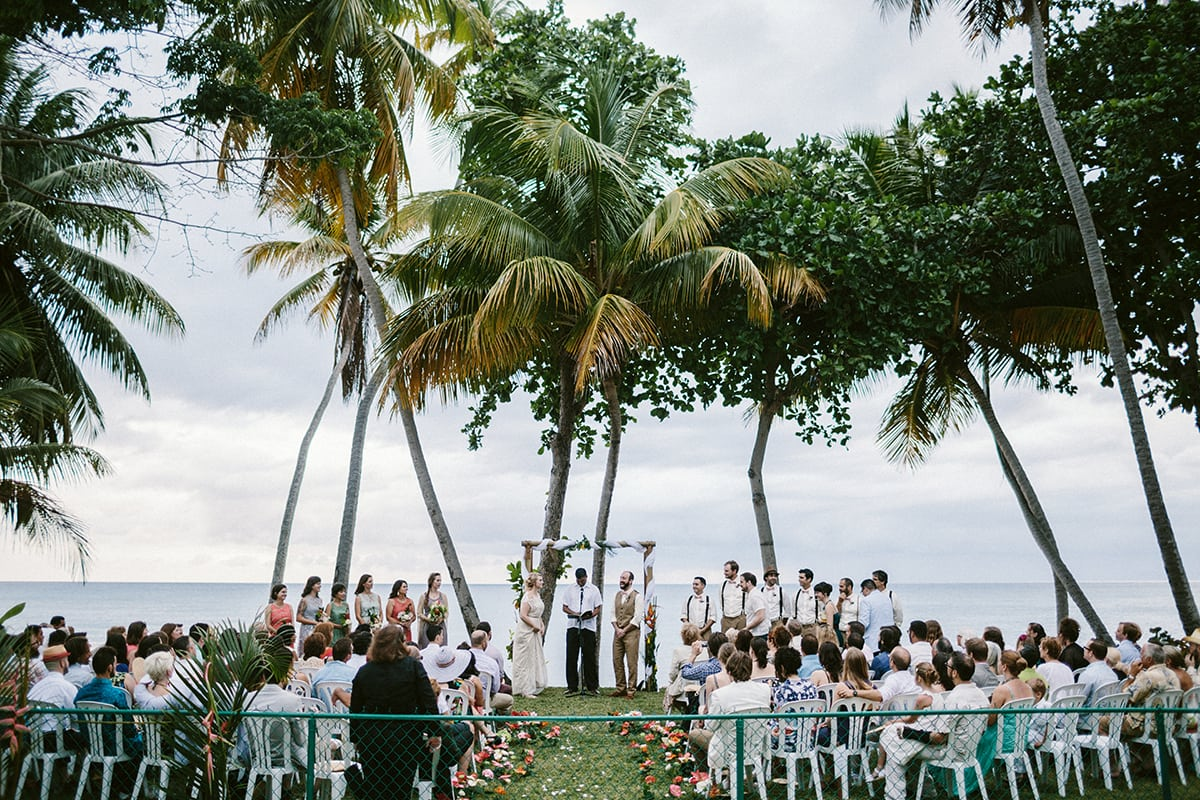A wedding ceremony taking place at the shore