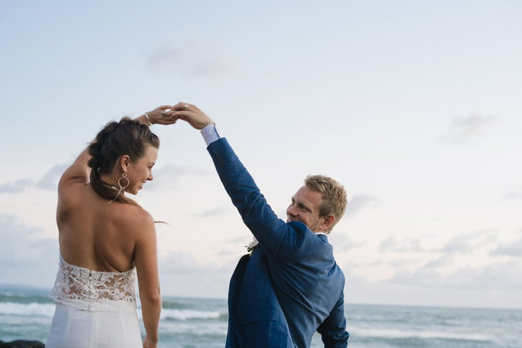 A man and woman dance at the beach