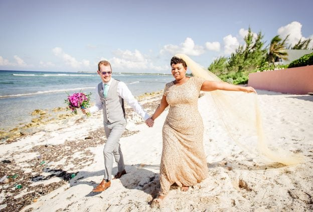 Bride in a glitter dress on a beach