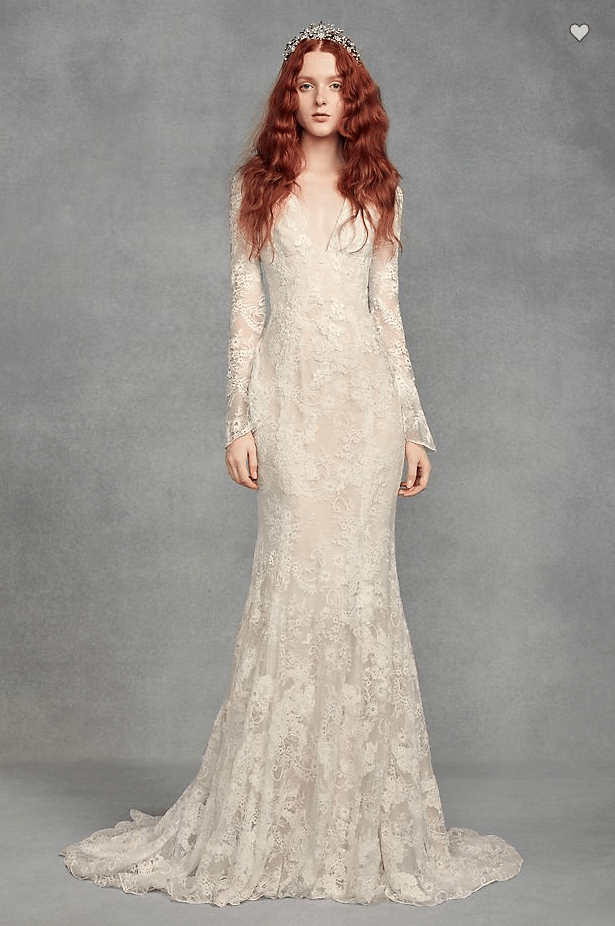 a woman ears an off-white long-sleeve v-neck lace dress