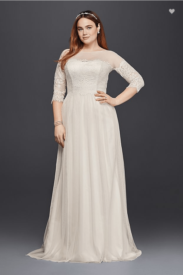"a woman wears an off-white dress with a lace bodice, illusion neckline, and lace ""off-the-shoulder"" sleeves"