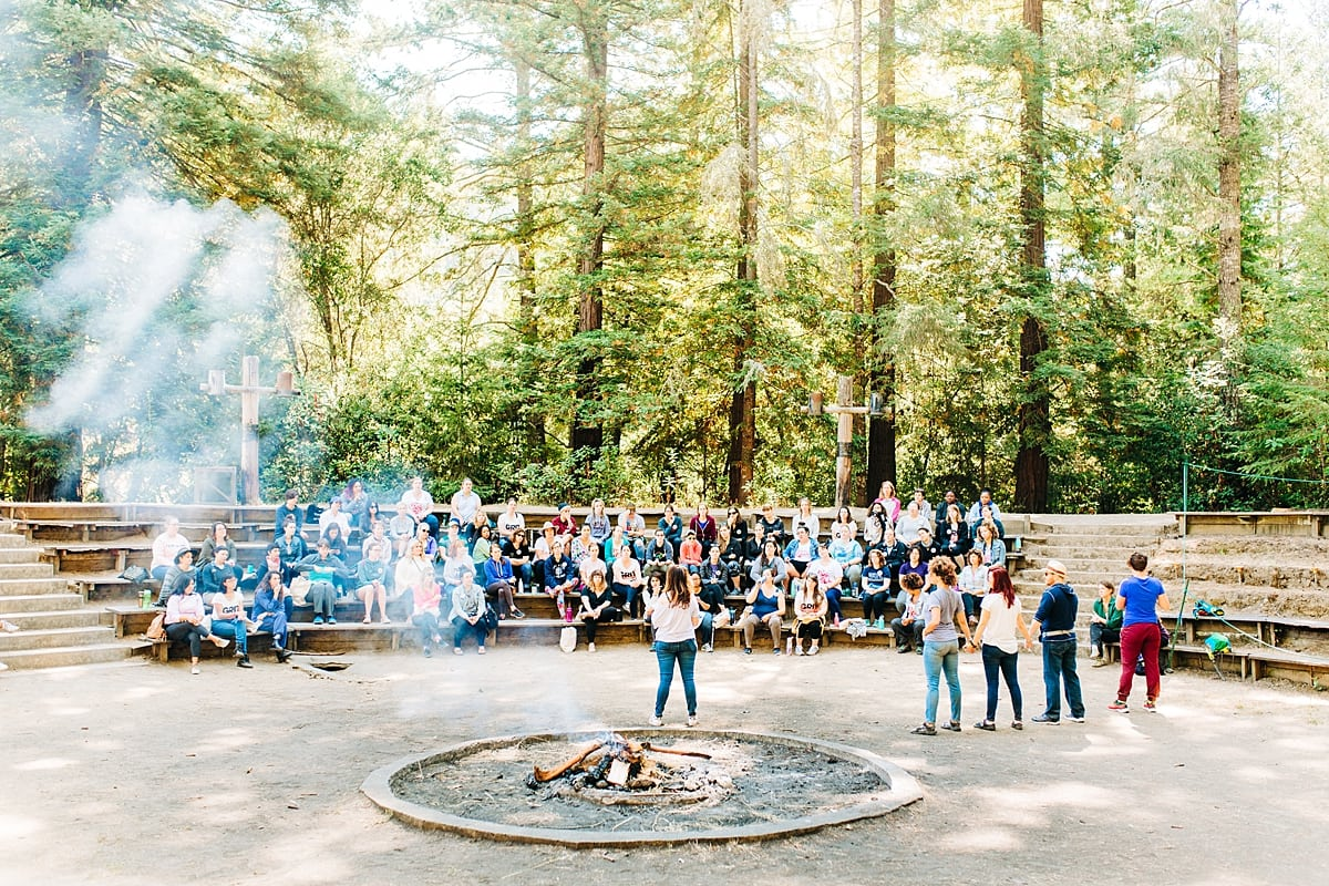 Farewell ceremony and bonfire, with the whole camp sitting on benches in an amphitheater among the trees