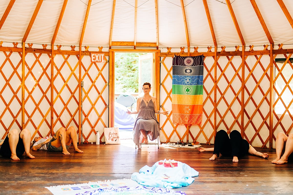 Women meditating in the yurt during Leah Tioxon's Chakra Alignment workshop at the compact summer camp in la Honda, CA