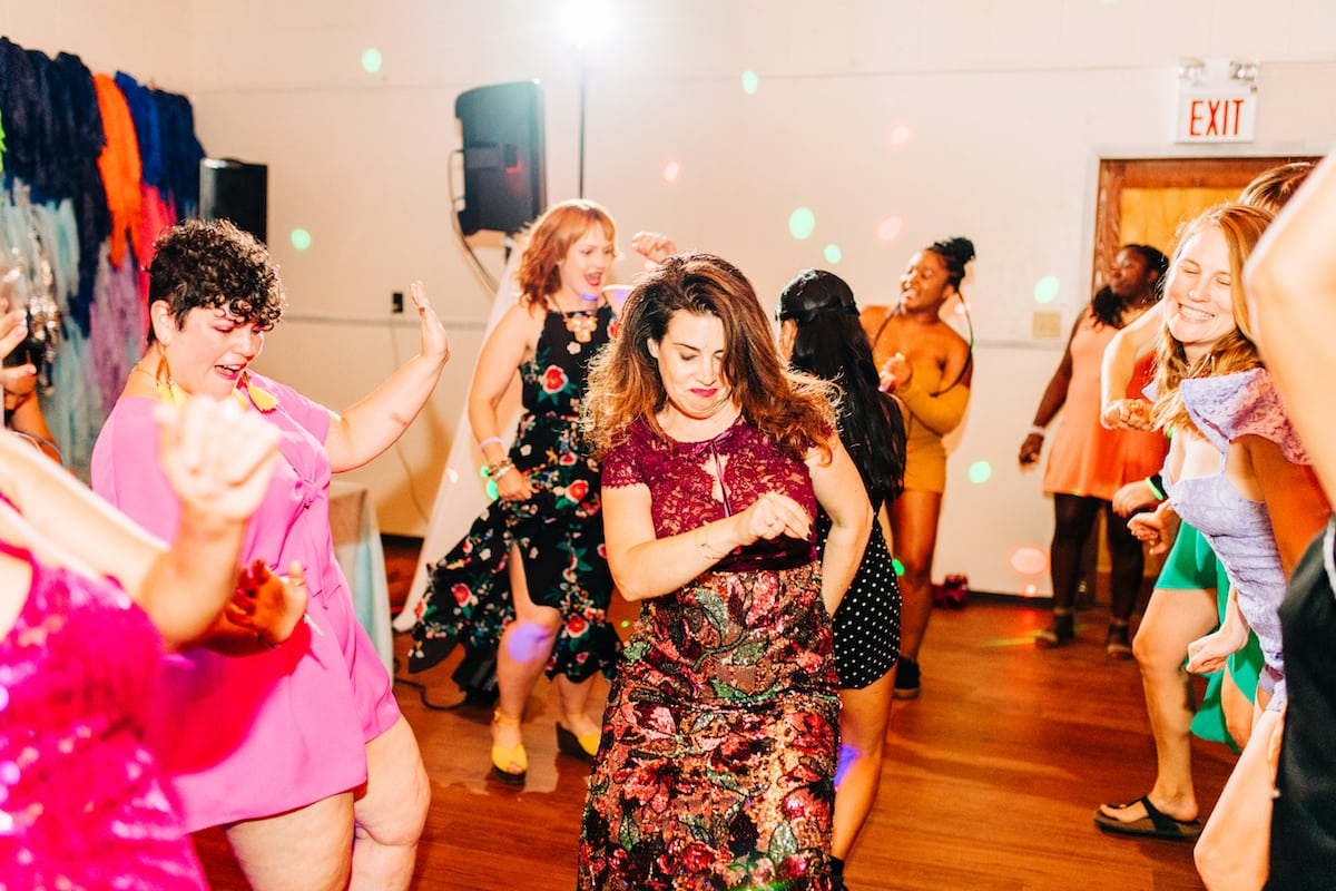 Women in colorful clothes getting down on the dance floor
