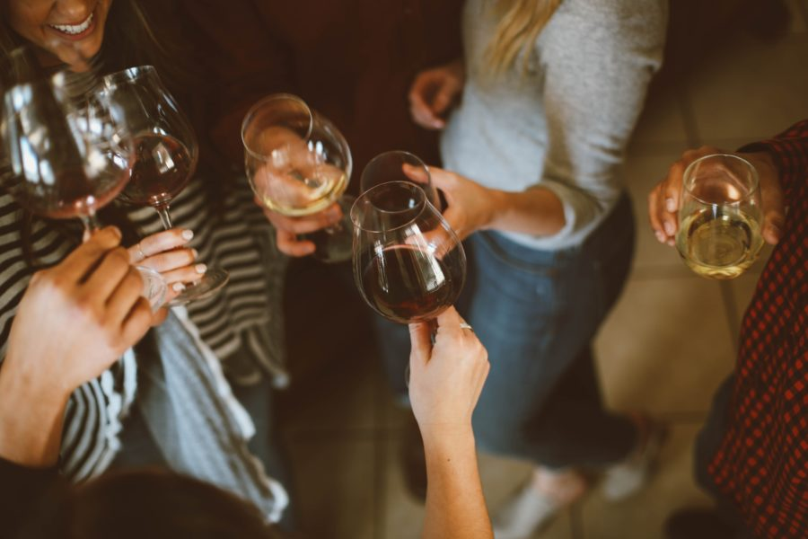 A group of people toasting with wine glasses at a party