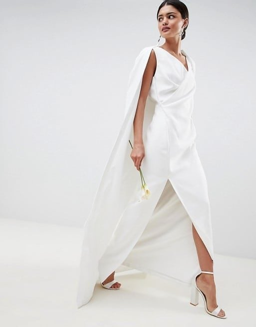 Woman in white caped dress walking