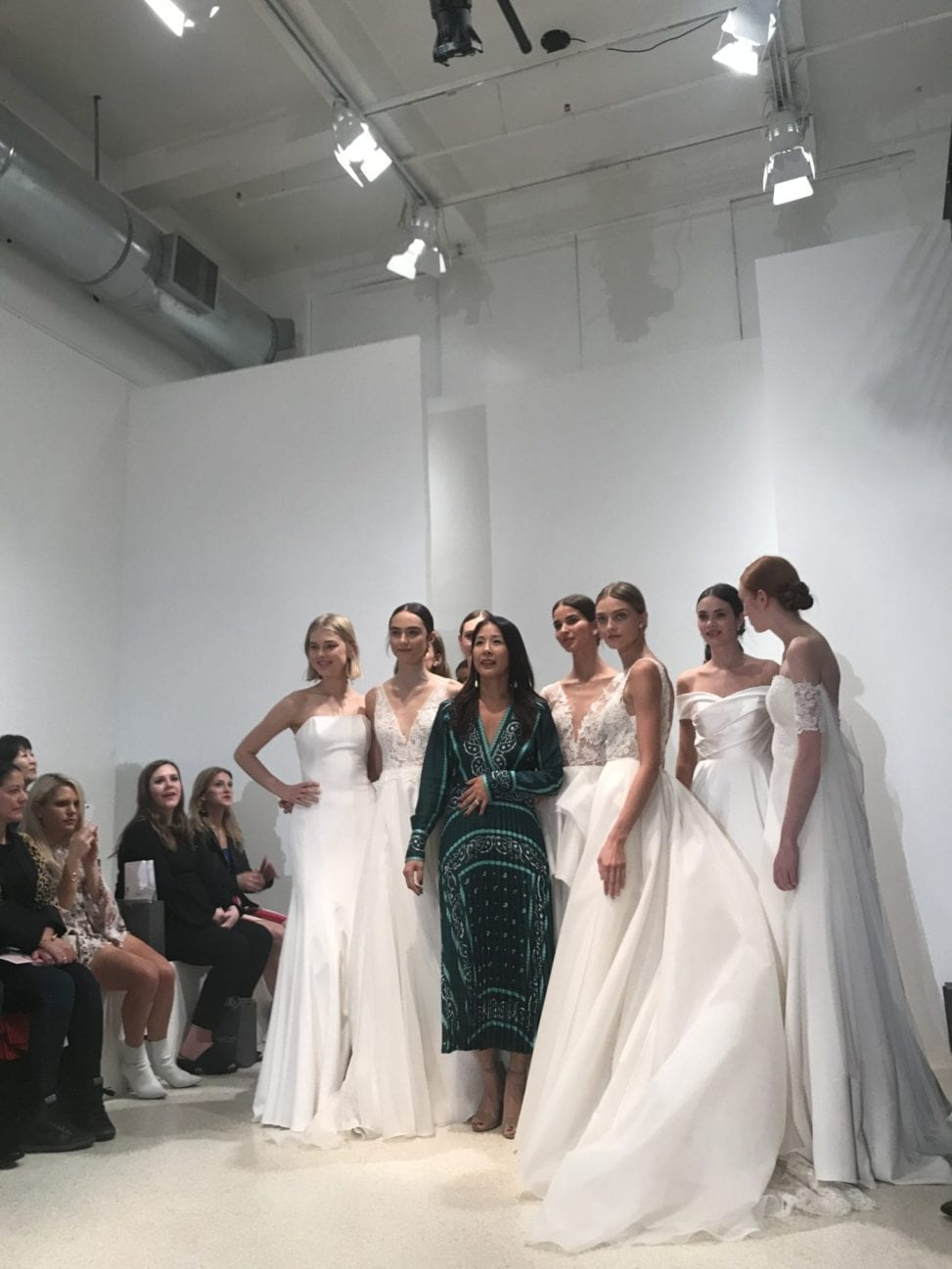 Jenny Yoo on the runway with the models showing her 2019 Fall collection at New York Bridal Fashion Week