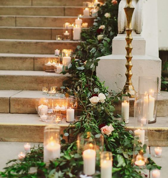 Candles and fir trimmings going down a staircase