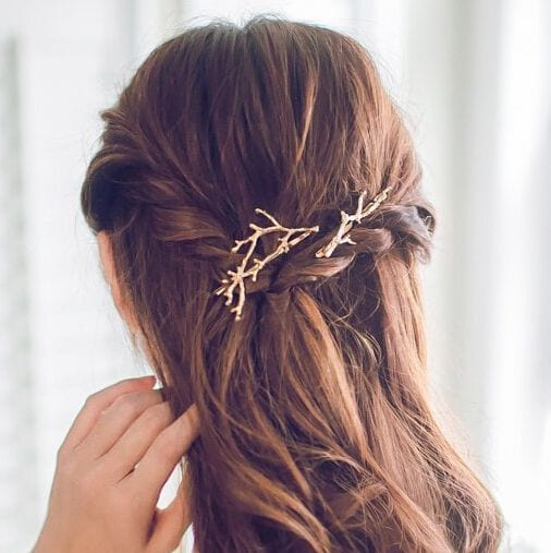 Winter wedding ideas for hair accessories—Brunette wearing branch hair decoration