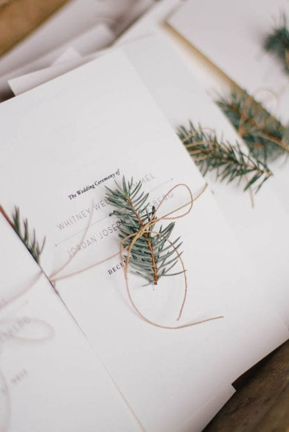 Winter wedding ideas for Invitations—wrapped in string and fir sprig