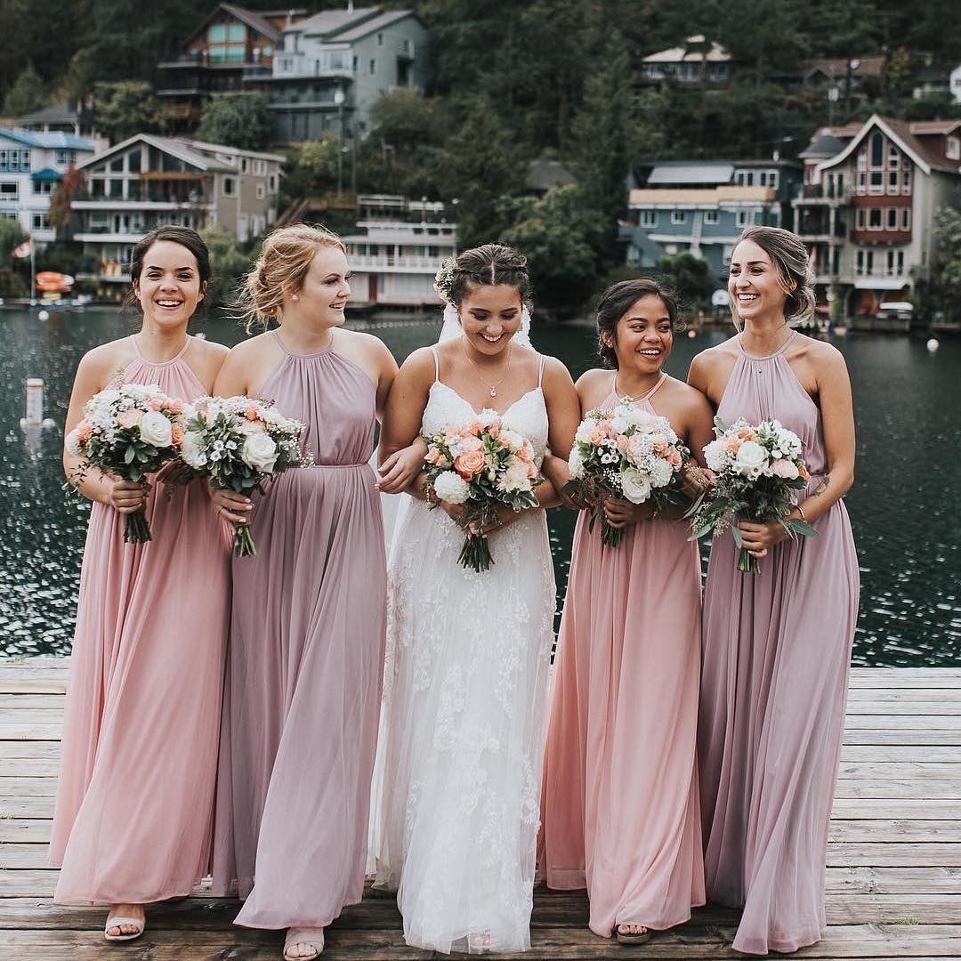 a7a2dc4941 bridesmaids wearing mismatched mauve and blush pink halter bridesmaid  dresses from david s bridal