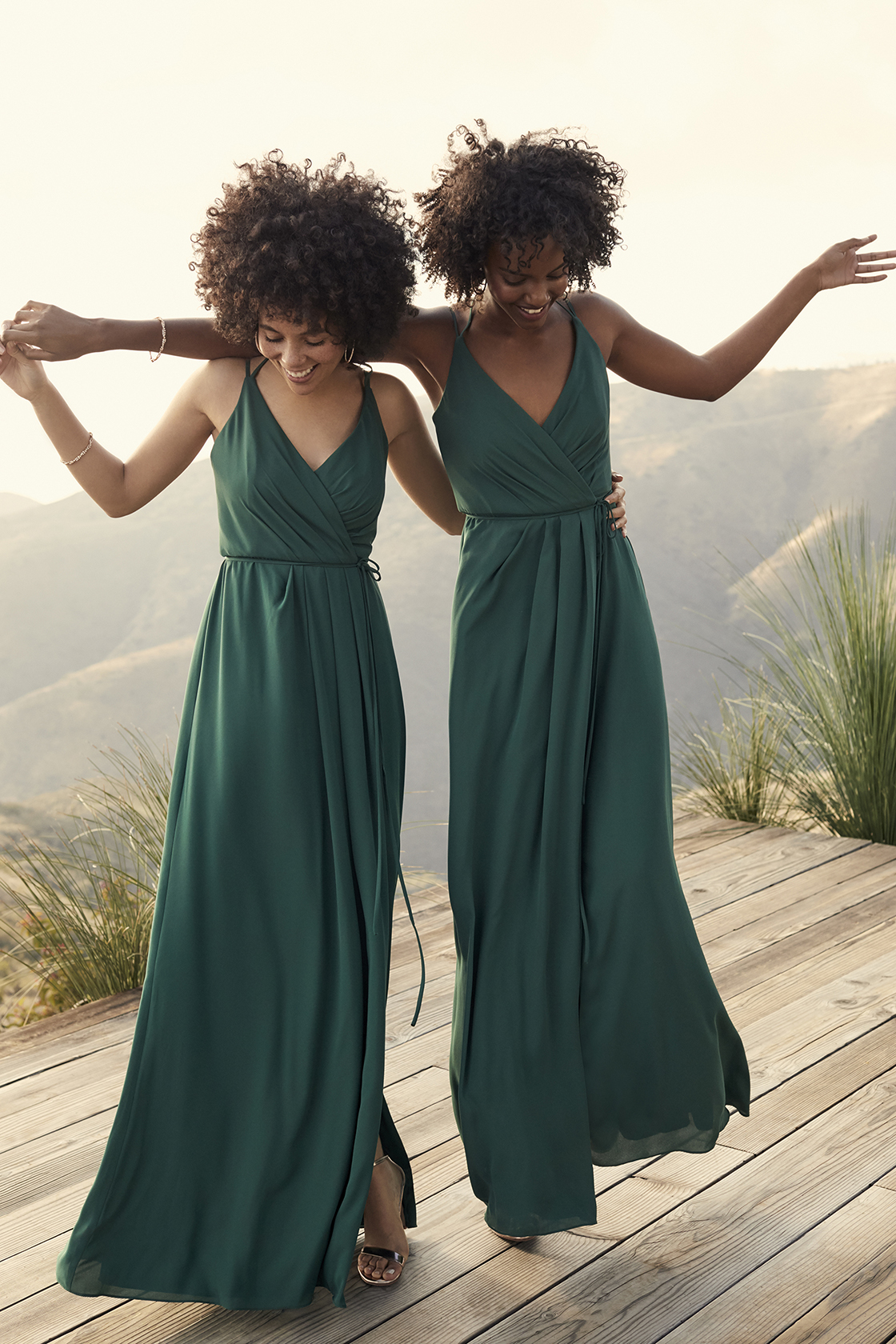 black bridesmaids with natural hairstyles wearing forest green spaghetti strap halter bridesmaid dresses from david's bridal