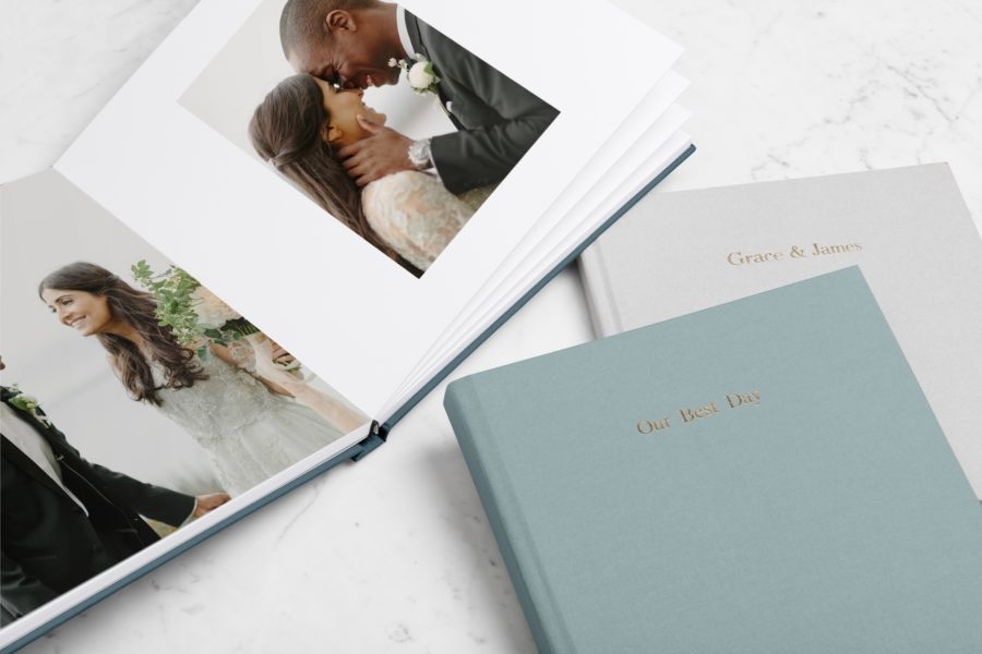 Several sample wedding albums from Artifact Uprising