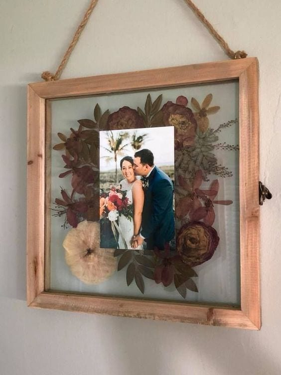 wedding ideas for bouquet preservation—pressed flowers in a frame with a wedding picture
