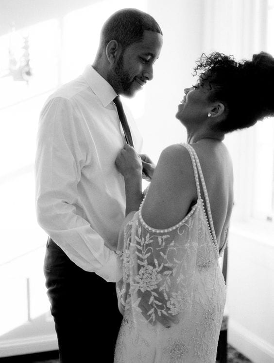 wedding ideas - african-american couple laughing and getting ready together