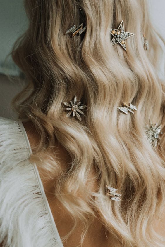 wedding ideas for hair accessories—lighting bolt and star hair jewelry adorning long blond waves