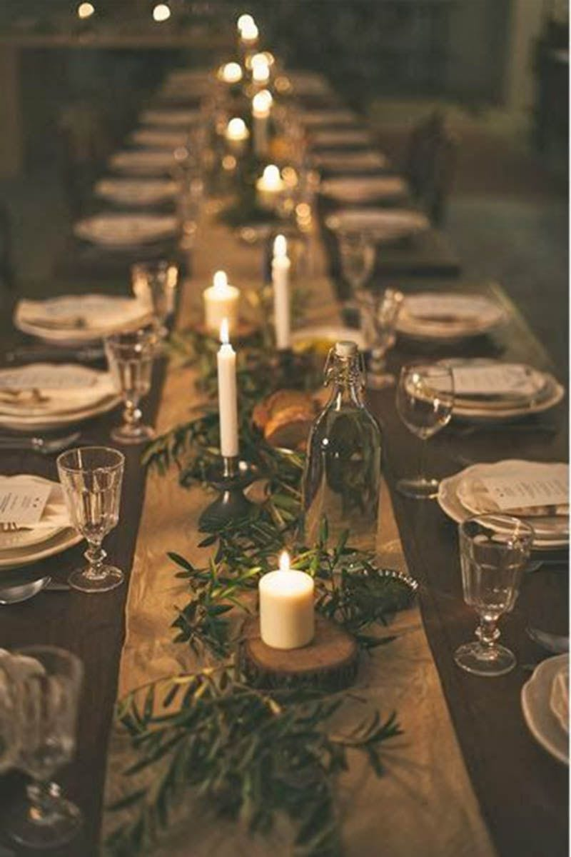 Winter wedding ideas for tablescape lighting—Moody, dark holiday tablescape with candles