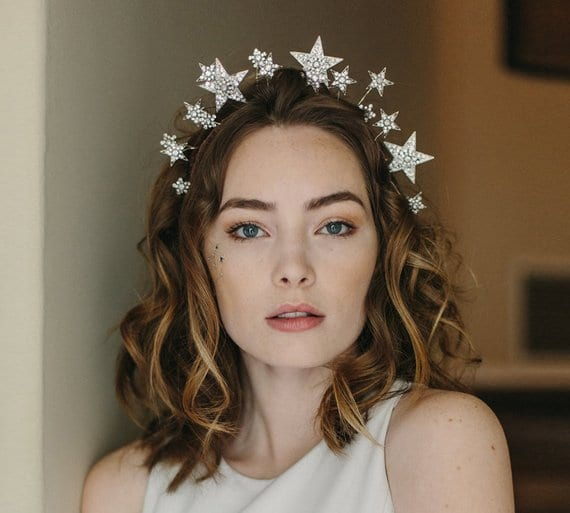 Winter wedding ideas for hair accessories—Brunette wearing star crown