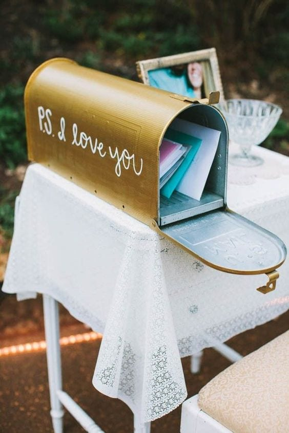 "wedding ideas for a card box—a hand-painted golden mail box that reads ""P.S. I love you"" on the side in script handwriting"