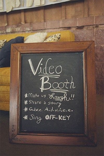 "wedding ideas for a video booth chalk board sign, which reads ""Video Booth *make us laugh!! *share a story *G.i.v.e A.d.v.i.c.e. * Sing off-key"""