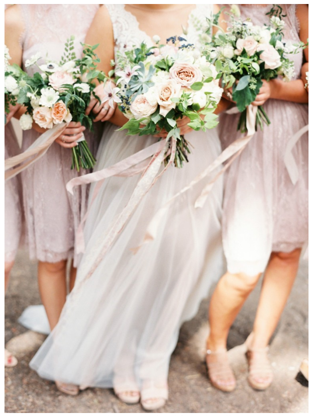 Bride and bridesmaids in cool pink and light blush winter wedding colors