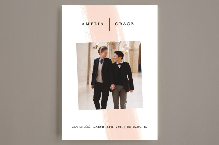 Minted save the date couple holding hands and walking