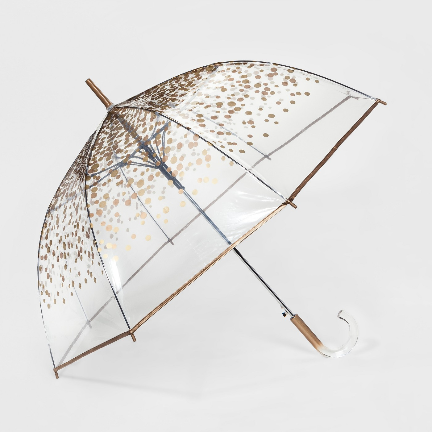 product shot of a clear wedding umbrella for rain with gold polka dots