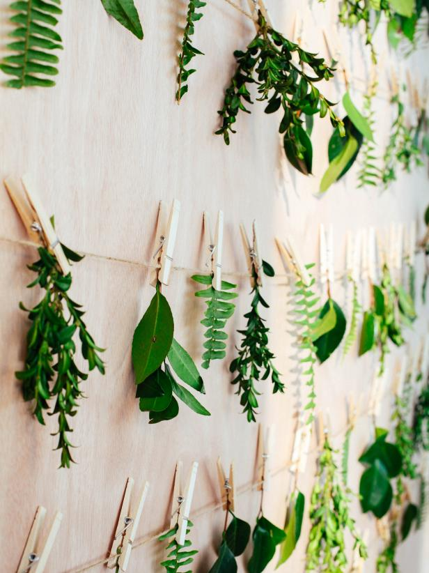 Small leaves strung on line with clothespins as an idea for bridal shower decorations