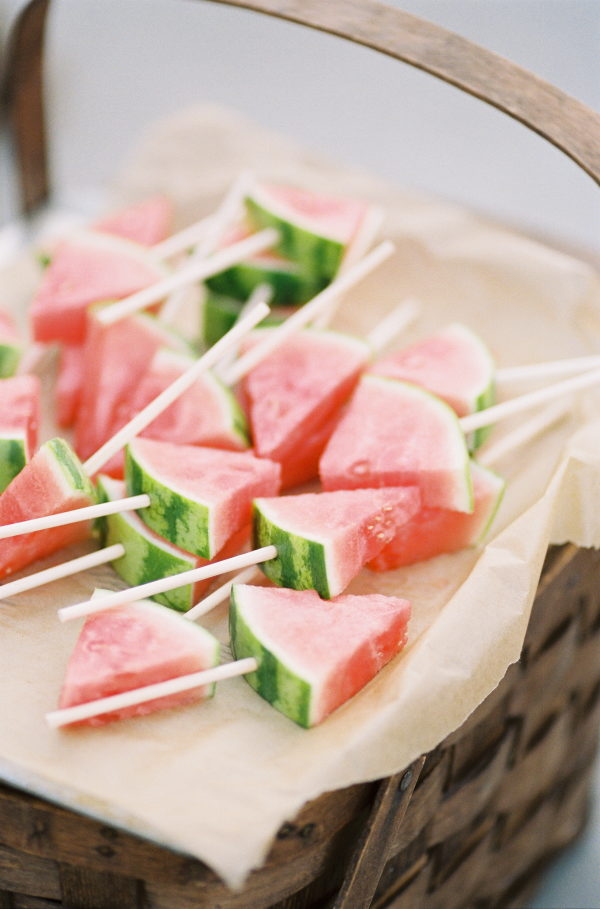 Watermelon triangle slices on sticks on a tray as an idea for bridal shower decorations