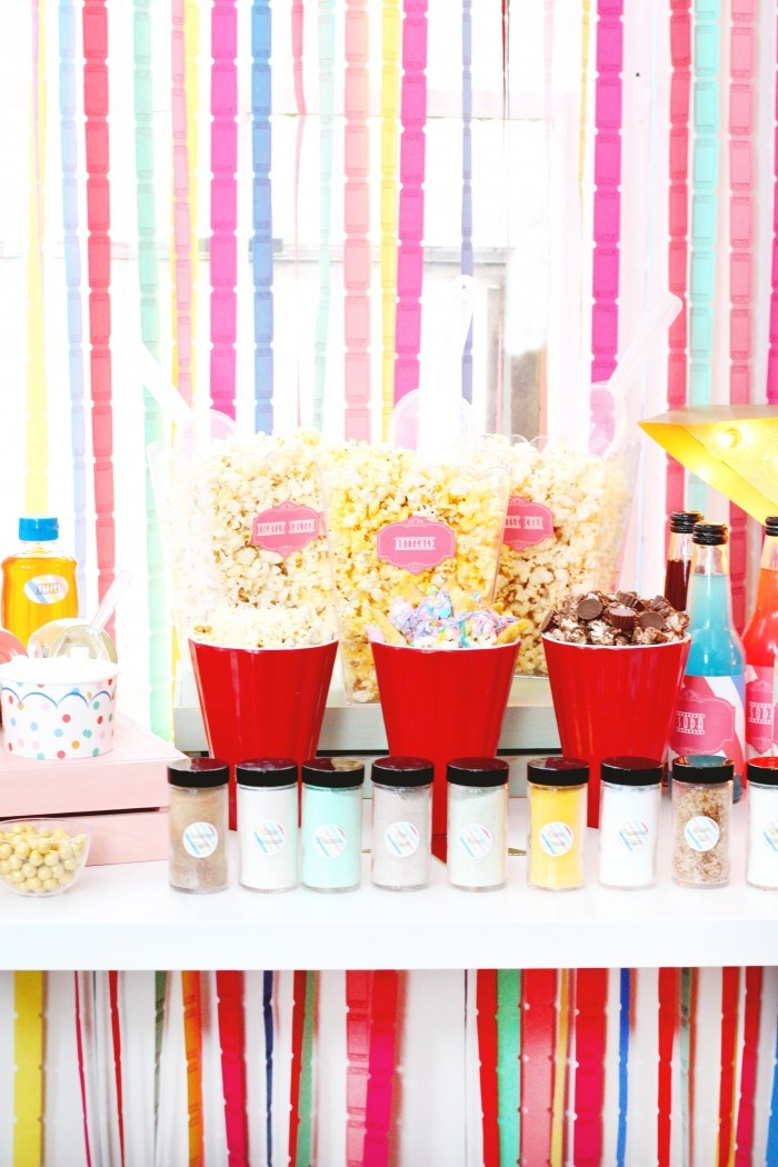 Colorful popcorn bar setup as an engagement party idea
