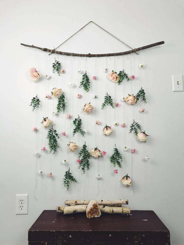 Strings of roses and leaves over dresser as an idea for bridal shower decorations