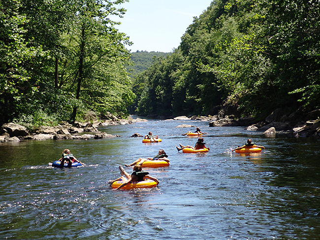 People tubing in river as an engagement party idea