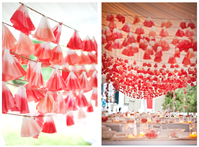 Red garlands over dinner tables in a tent as an idea for bridal shower decorations