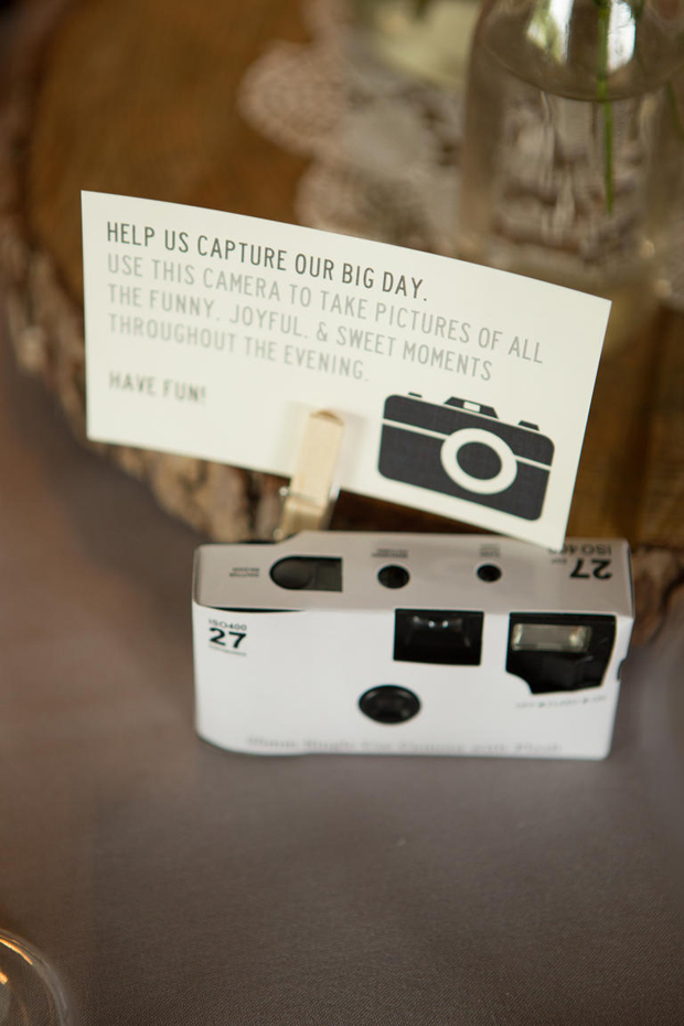 Disposable camera with sign on table