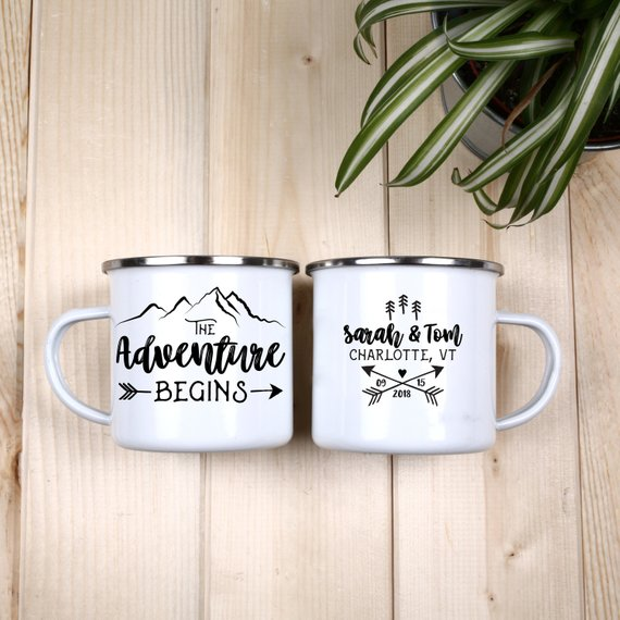Two camp mugs on wooden table