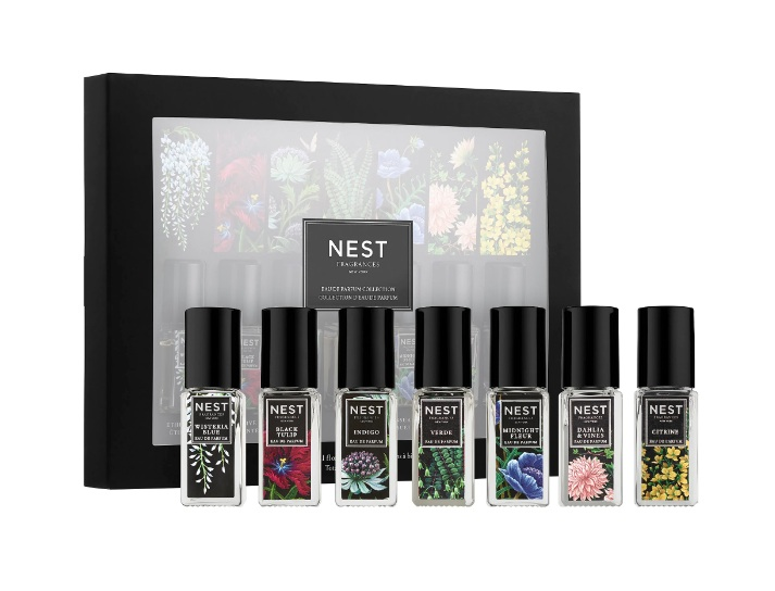 Assortment of seven NEST brand perfumes in front of box for bridal shower favors