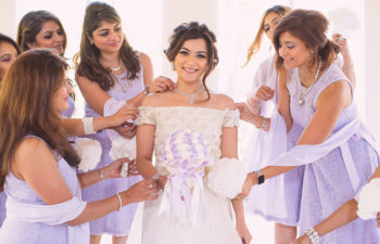 A bride is attended to by her bridesmaids