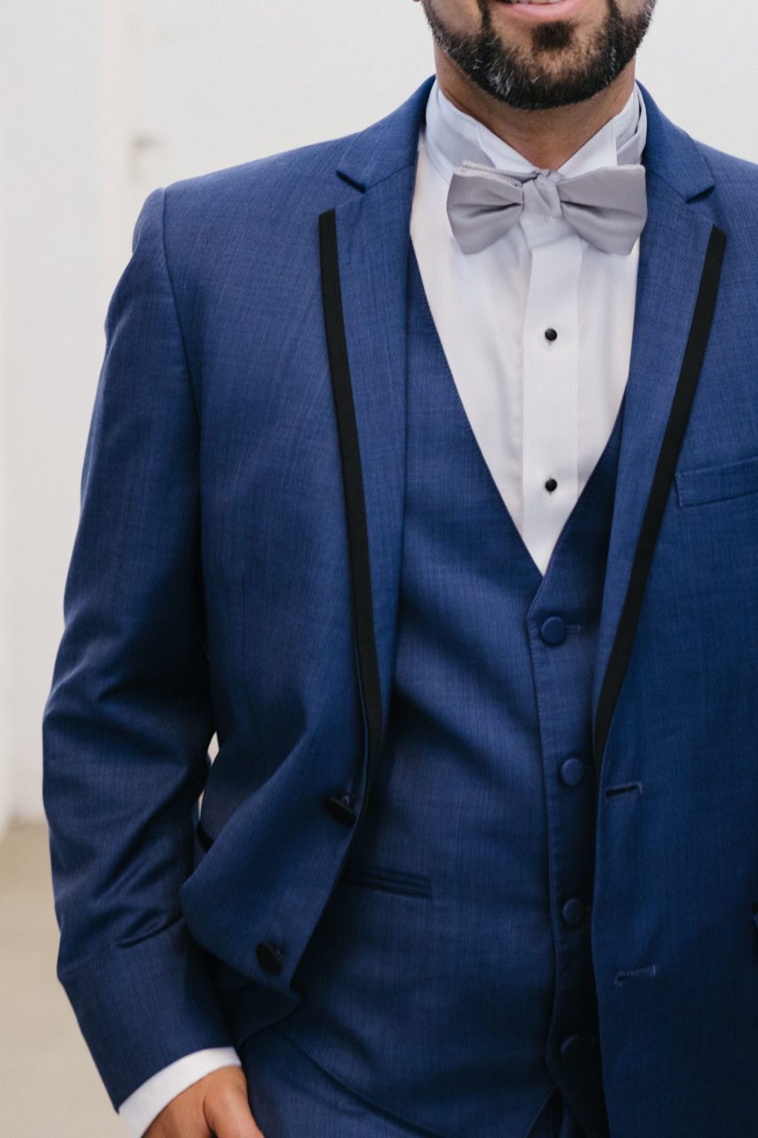 Close up of a models midsection wearing a Generation Tux suit