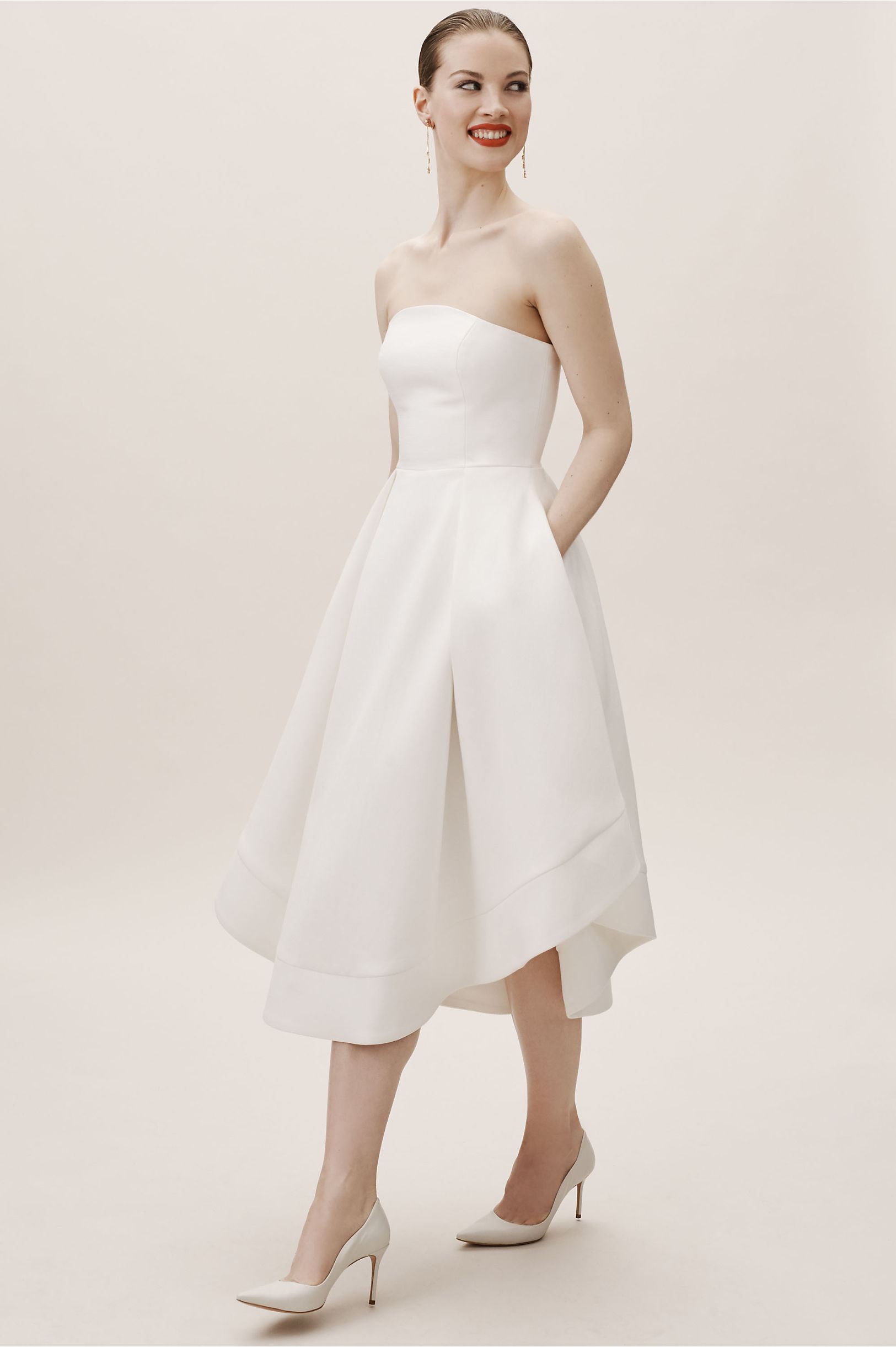 woman wearing a short strapless simple wedding dress