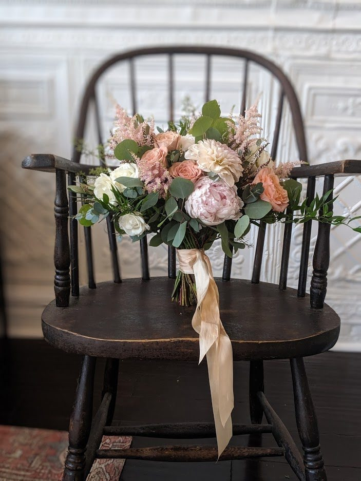 A bridal bouquet on a chair.