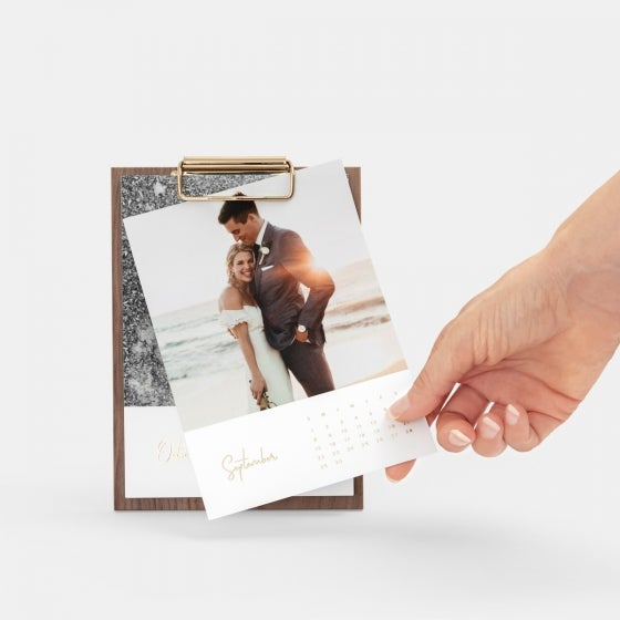 A calendar card of a wedding couple