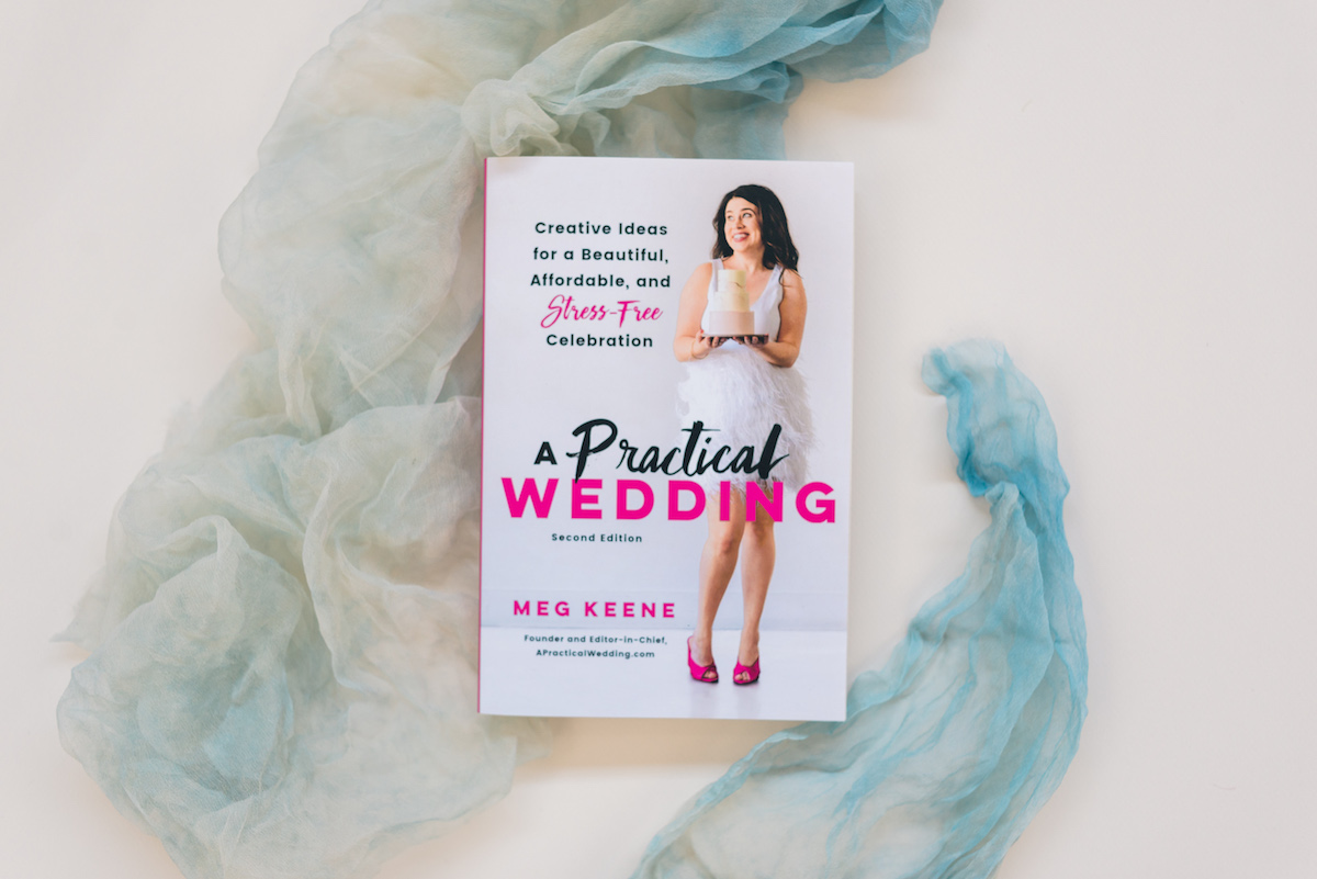 Flat lay image of Meg Keene's new edition of her book A Practical Wedding